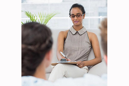female therapist talking with couple