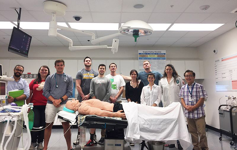 Master's students participating in the simulation laboratory.
