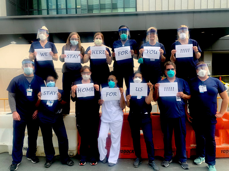 group of doctors & nurses outside hospital during COVID-19 pandemic
