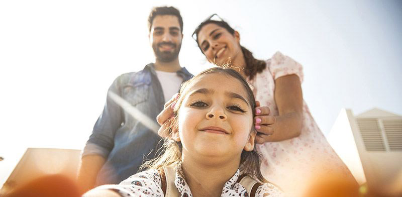 girl taking selfie with parents